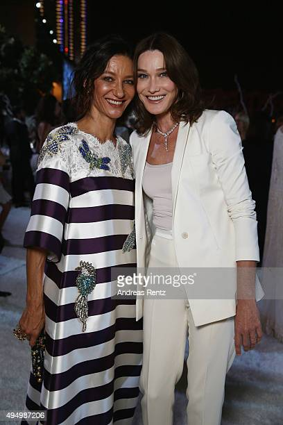 Model Marpessa Hennink and Carla Bruni attend the Gala event during the Vogue Fashion Dubai Experience 2015 at Armani Hotel Dubai on October 30 2015...