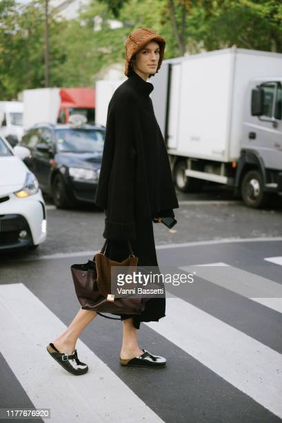 Model Marte Mei van Haaster poses weareing Birkenstock sandals after the Aider Hackermann show at the Palais de Tokyo during Paris Fashion Week...