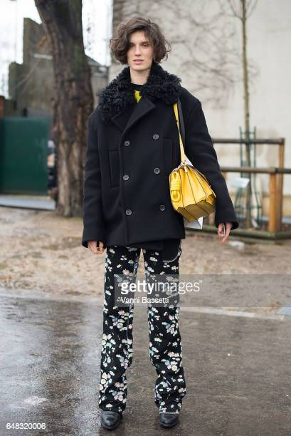 Model Marte Mei van Haaster poses with a Loewe bag after the Celine show at the Tennis Club de Paris during Paris Fashion Week Womenswear FW 17/18 on...