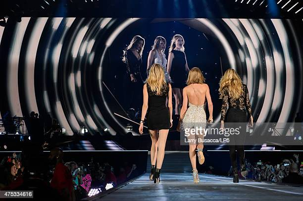 Model Martha Hunt musician Taylor Swift and model Gigi Hadid perform on stage during the 1989 World Tour Live at Ford Field on May 30 2015 in Detroit...