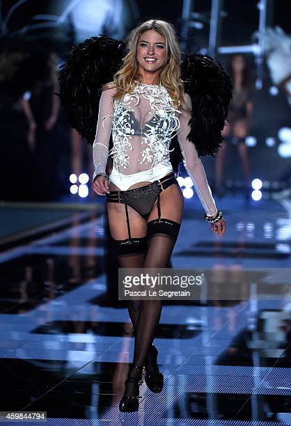 Model Martha Hunt walks the runway at the annual Victoria's Secret fashion show at Earls Court on December 2 2014 in London England
