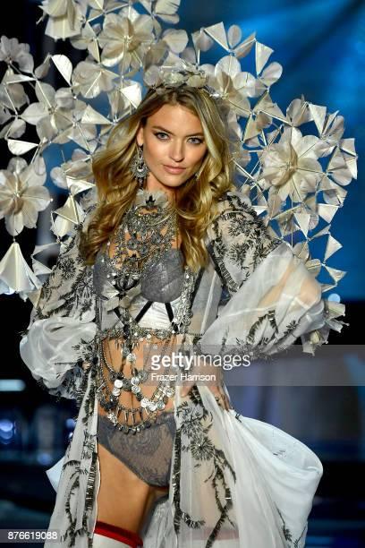 Model Martha Hunt walks the runway during the 2017 Victoria's Secret Fashion Show In Shanghai at MercedesBenz Arena on November 20 2017 in Shanghai...