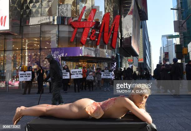 Model Mary Ann Persad and PETA supporter poses during a protest outside HM's flagship store in New York City on January 18 as she pretends to have...