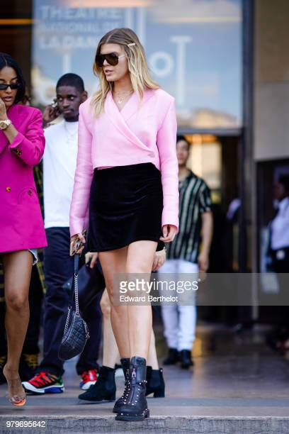 Model Maryna Linchuk wearing pink blouse black mini skirt outside OffWhite during Paris Fashion Week Menswear SpringSummer 2019 on June 20 2018 in...