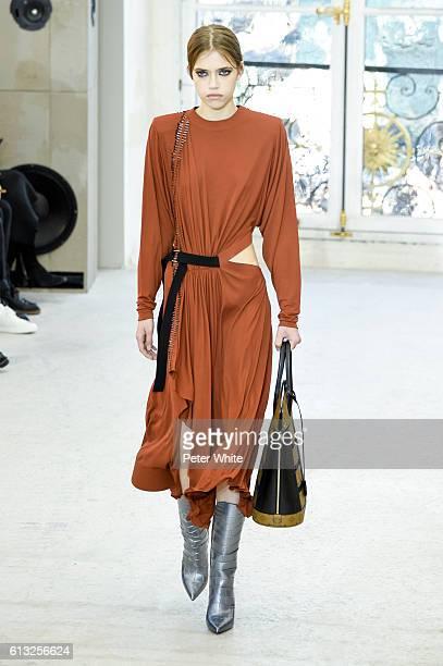 Model Masha Skokova walks the runway during the Louis Vuitton show as part of the Paris Fashion Week Womenswear Spring/Summer 2017 on October 5 2016...
