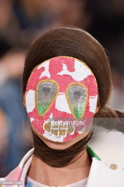A model mask detail walks the runway during the Thom Browne show as part of the Paris Fashion Week Womenswear Spring/Summer 2019 on September 30 2018...