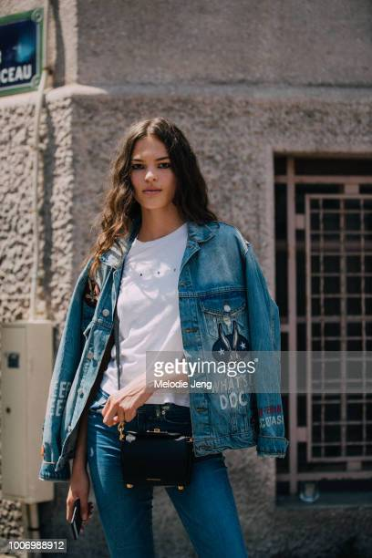 Model Matea Brakus wears a denim jacket white shirt and Alexander McQueen crossbody bag during Couture Fall/Winter 2018 Fashion Week on July 1 2018...
