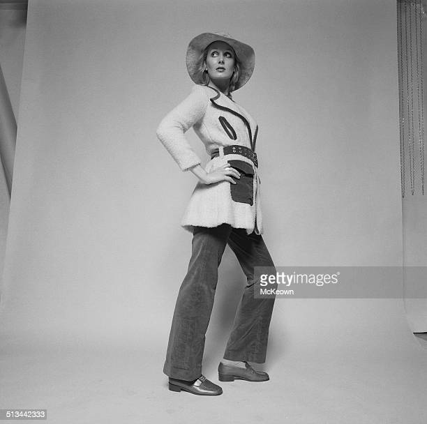 Model Maureen Byrne poses wearing trousers and a winter jacket 29th September 1969