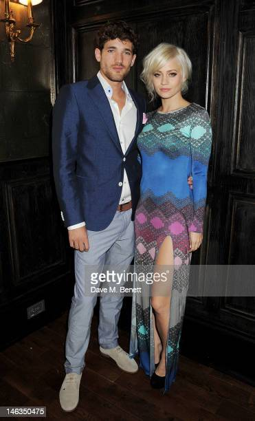 Model Max Rogers and Kimberly Wyatt attend as Tommy Hilfiger hosts a cocktail party to celebrate the launch of London Collections Men at The Scotch...