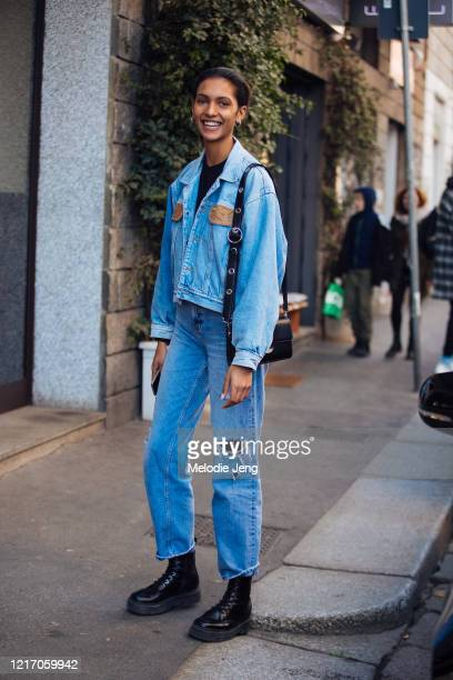 Model Mayara Moreno weasr a denim jacket, blue jeans, and black boots after the Agnona show during Milan Fashion Week Fall/Winter 2020-2021 on...