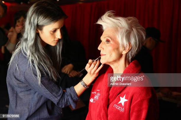 Model Maye Musk prepares backstage at the American Heart Association's Go Red For Women Red Dress Collection 2018 presented by Macy's at Hammerstein...