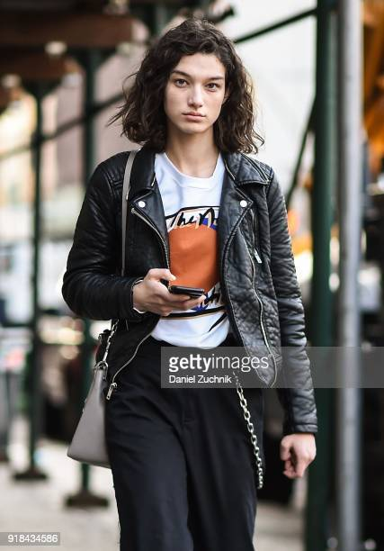 Model McKenna Hellam is seen wearing a leather jacket and black pants outside the Esteban Cortazar show during New York Fashion Week Women's A/W 2018...
