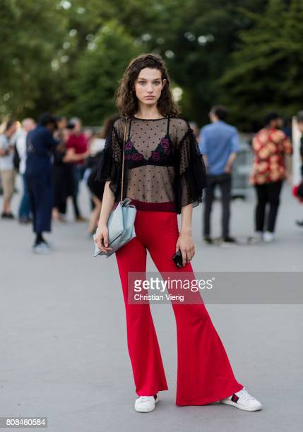 Model Mckenna Hellam wearing sheer top red flared pants outside Alexandre Vauthier during Paris Fashion Week Haute Couture Fall/Winter 20172018 Day...