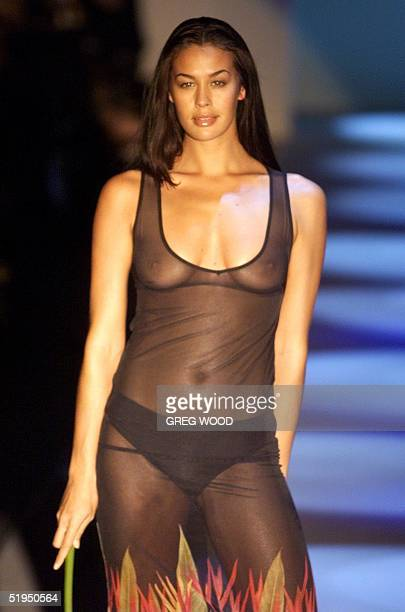 Model Megan Gale parades swim wear by C Design in the Swim and Resort Collection show during a presentation at Australian Fashion Week in Sydney 10...