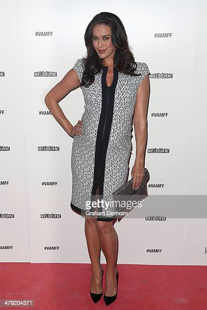 Model Megan Gale poses as she arrives for the 2014 Virgin Australia Melbourne Fashion Festival Opening Event presented by David Jones at Docklands on...