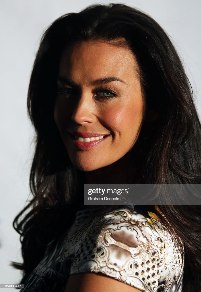 Model Megan Gale poses as she arrives for the L'Oreal Melbourne Fashion Festival Opening Event presented by David Jones at Docklands on March 19, 2013 in Melbourne, Australia.
