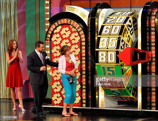 Model Megan Wilson and entertainer Joey Fatone watch contestant Joan Butler of Georgia spin a wheel as Fatone hosts The Price Is Right Live Stage...
