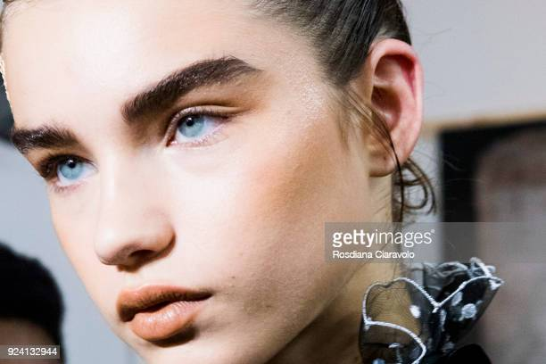 Model Meghan Roche is seen backstage ahead of the Philosophy Di Lorenzo Serafini show during Milan Fashion Week Fall/Winter 2018/19 on February 24...