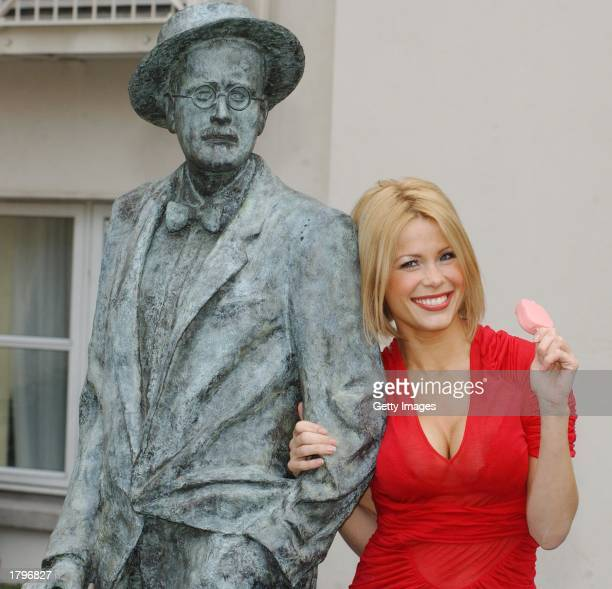 Model Melinda Messenger poses with statue of famous Irish writer James Joyce at the launch of the limited edition Magnum 7 Deadly Sins ice cream...