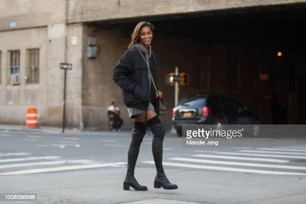 Model Melodie Monrose wears a black jacket and black kneehigh sock boots during New York Fashion Week Men's Fall/Winter 2017 on February 2 2017 in...