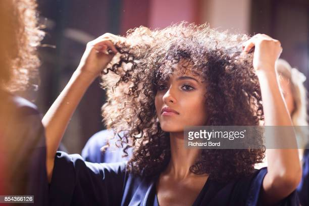 Model Melodie Vaxelaire prepares backstage prior the Etam show as part of Paris Fashion Week Womenswear Spring/Summer 2018 on September 26 2017 in...