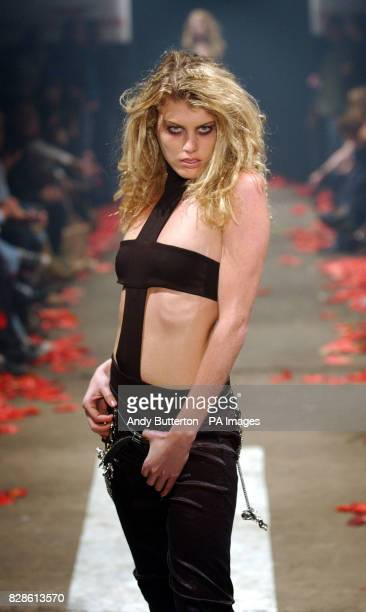 Model Meredith Ostrum Nick Rhodes girlfriend wears a creation by Scott Henshall on the catwalk during his autumn/winter 2003 show as part of London...