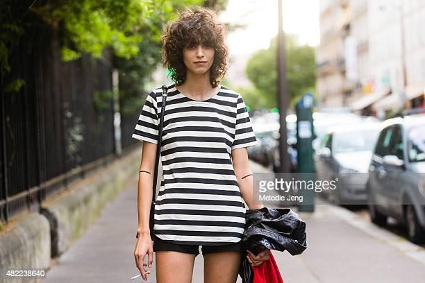 Model Mica Arganaraz carries a Schott leather motorcycle jacket on Day 1 of Paris Fashion Week Men's SS16 on June 24 2015 in Paris France
