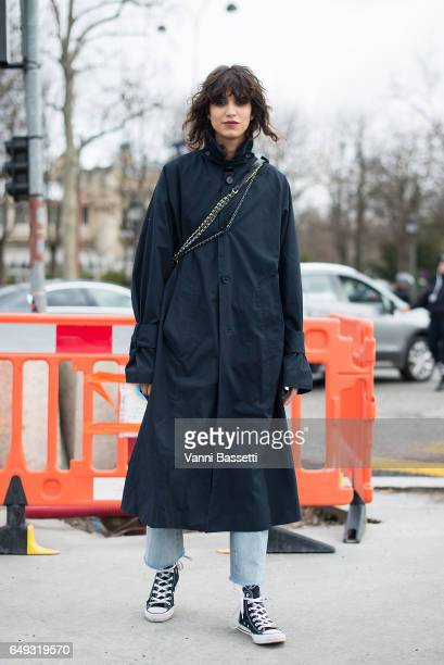 Model Mica Arganaraz poses wearing Converse shoes after the Chanel show at the Grand Palais during Paris Fashion Week Womenswear FW 17/18 on March 7...