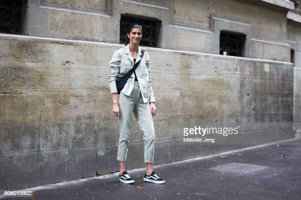 Model Mica Arganaraz wears black Vans sneakers after the Proenza Schouler show on July 2 2017 in Paris France