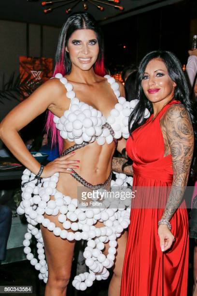 Model Micaela Schaefer and German singer Julia Jasmin Ruehle alias JJ attends the 'Nights of The Nights' event at Amano Grand Central on October 11...