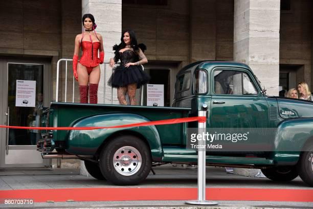 Image contains nudity Model Micaela Schaefer and German singer Julia Jasmin Ruehle alias JJ during the red carper Photo Call of Venus Erotic Fair...