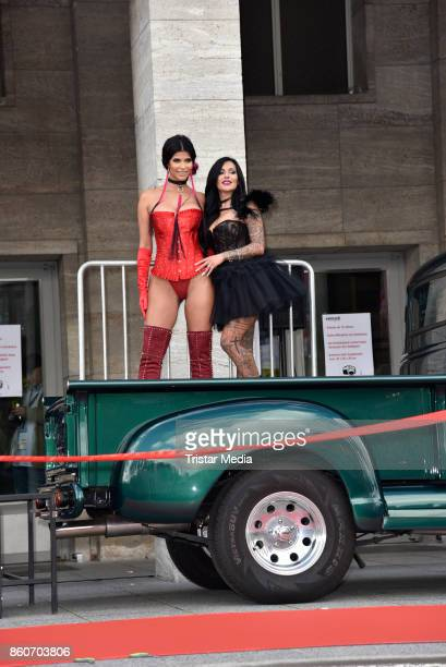 Image contains nudity.) Model Micaela Schaefer and German singer Julia Jasmin Ruehle alias JJ during the red carper Photo Call of Venus Erotic Fair...