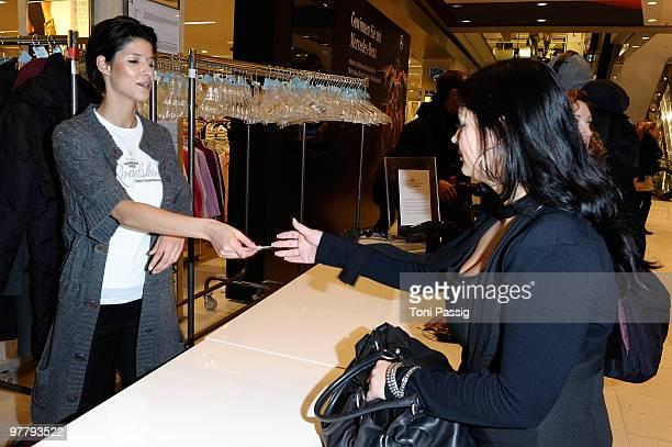 Model Michaela Schaefer works as a hostess in the cloakroom at the Peek Cloppenburg Fashion Roadshow at Peek Cloppenbur flagship store on March 16...