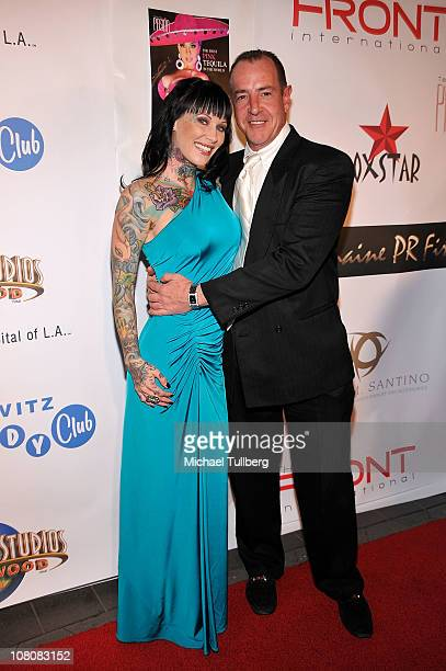 Model Michelle Bombshell McGee and Michael Lohan arrive at Hollywood publicist Charmaine Blake's 1st Annual Golden Globes Viewing Party To Help...
