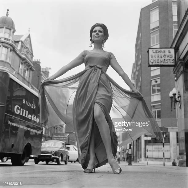 Model Michelle Vincente takes part in a fashion show in London, 25th August 1965.