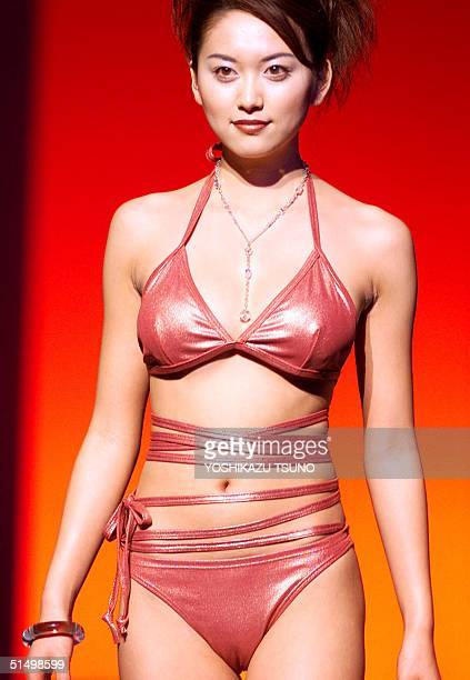 Model Miho Nishimura displays a bikini swimsuit by Japanese apparel giant Teijin made of Teijin's new fabric Cortico 05 January 2001 The swimsuit...