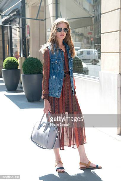 Model Milana Kruz wears a vintage dress and denim waistcoat with a Givenchy bag and Miu Miu shoes on day 2 of Paris Fashion Week Haute Couture...