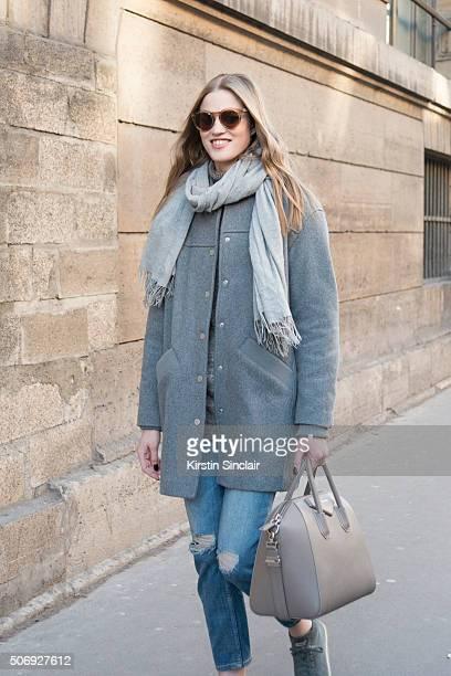 Model Milana Kruz wears an Eleven Paris coat Rag and Bone scarf Zara jeans Miu Miu shoes Givenchy bag and Illesteva sunglasses on day 2 of Paris...