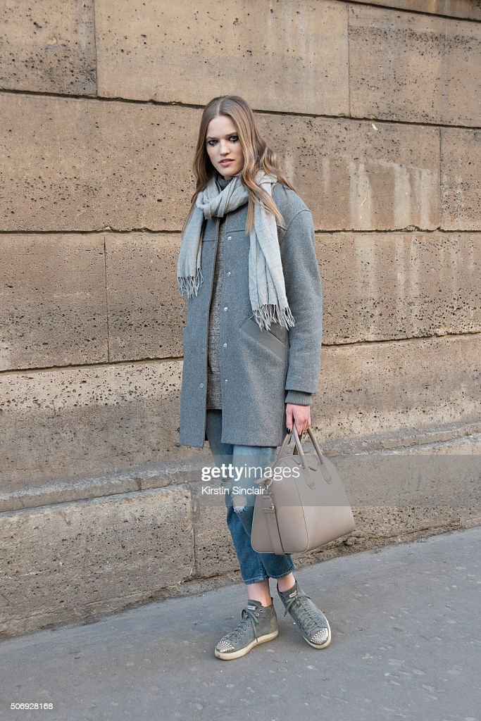 Model Milana Kruz wears an Eleven Paris coat, Rag and Bone scarf, Zara jeans, Miu Miu shoes and a Givenchy bag on day 2 of Paris Haute Couture Fashion Week Spring/Summer 2016, on January 25, 2015 in Paris, France.