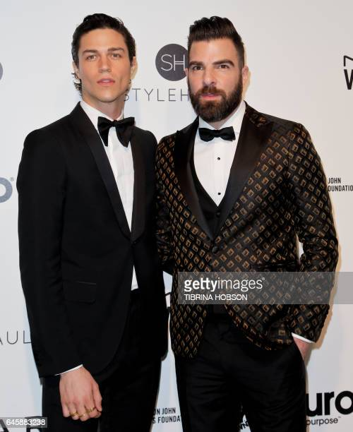 US model Miles McMillan and US actor Zachary Quinto pose upon their arrival for the 25th annual Elton John AIDS Foundation's Academy Awards Viewing...