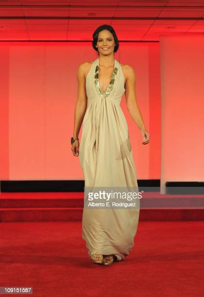 Model Mindy walks the runway wearing a designer Miriam Cecilia Carlson dress at the Oscars Designer Challenge 2011 on February 15 2011 in Beverly...