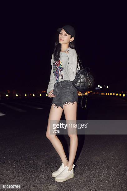 Model Ming Xi arrives at airport to set out for Milan Fashion Week Spring/Summer 2017 on September 23 2016 in Shanghai China