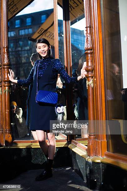 Model Ming Xi exits the Balmain show in a Kiko Mizuhara for Opening Ceremony top Chanel purse and Fendi accessory at the Grand Hotel on Day 3 of...