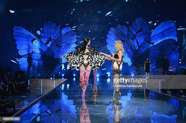 Model Ming Xi from China walks the runway while singer Ellie Goulding performs during the 2015 Victoria's Secret Fashion Show at Lexington Avenue...