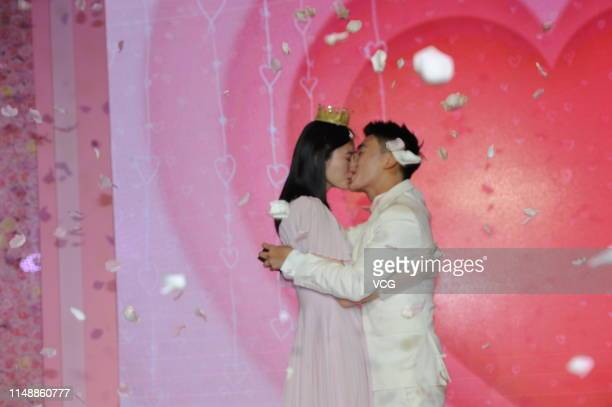 Model Ming Xi Mengyao and Mario Ho Yaukwan son of SJM Holdings founder Stanley Ho kisses after Mario Ho proposed to Ming Xi at L' Avenue Shanghai on...