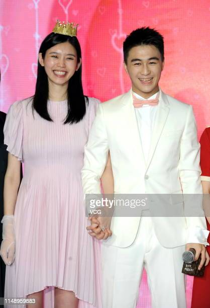 Model Ming Xi Mengyao and Mario Ho Yaukwan son of SJM Holdings founder Stanley Ho hold hands after Mario Ho proposed to Ming Xi at L' Avenue Shanghai...