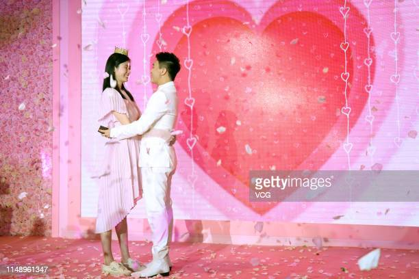 Model Ming Xi Mengyao and Mario Ho Yaukwan son of SJM Holdings founder Stanley Ho hug each other after Mario Ho proposed to Ming Xi at L' Avenue...