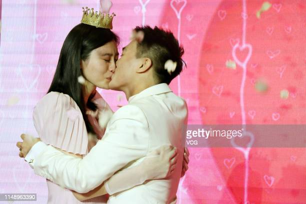 Model Ming Xi Mengyao and Mario Ho Yaukwan son of SJM Holdings founder Stanley Ho kiss after Mario Ho proposed to Ming Xi at L' Avenue Shanghai on...