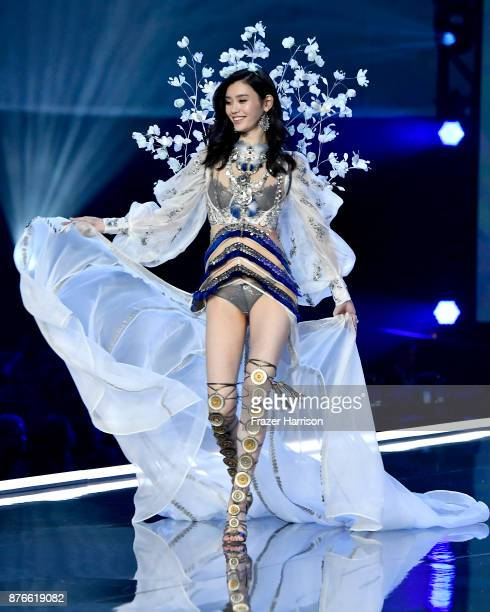 Model Ming Xi walks the runway during the 2017 Victoria's Secret Fashion Show In Shanghai at MercedesBenz Arena on November 20 2017 in Shanghai China
