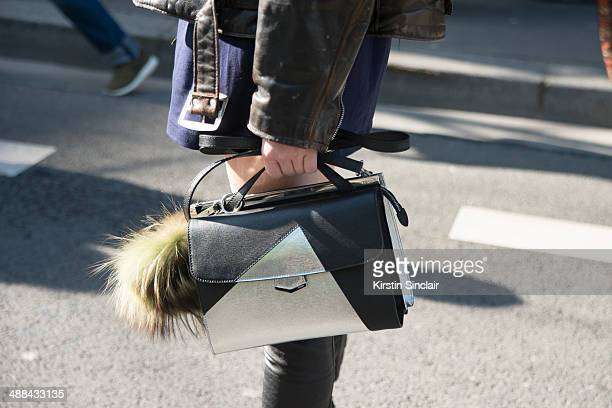 Model Ming Xi wears a vintage Harley Davidson jacket Fendi Monster Pom Pom and bag on day 6 of Paris Collections Women on March 02 2014 in Paris...